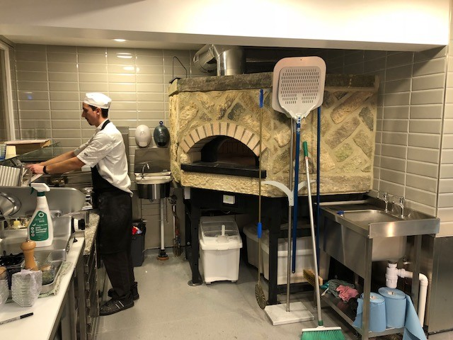 Man working Boun Apps Pizza Oven